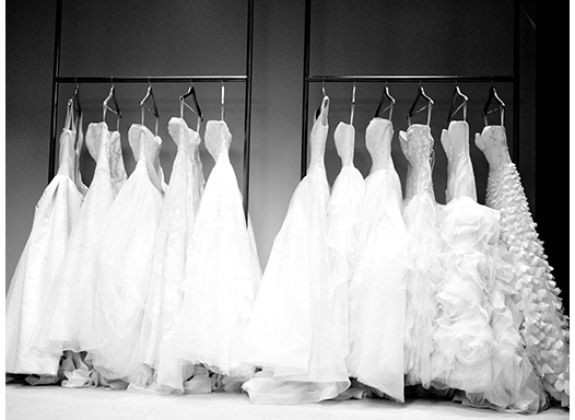 Wedding dresses on rolling racks at Be Your Own Bride shoot