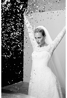 Model bride behind the scenes with confetti