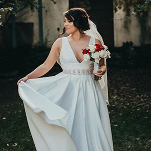 Bride twirling her wedding dress skirt