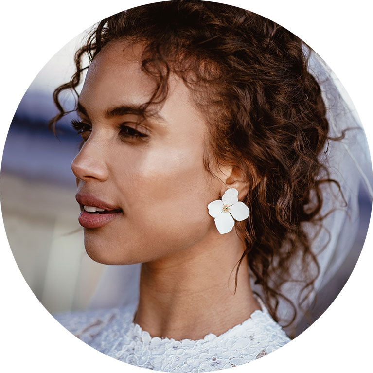 Close up of bride with white flower earrings