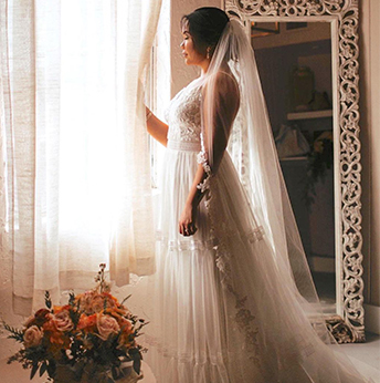 Real bride wearing lace Melissa Sweet gown and dancing
