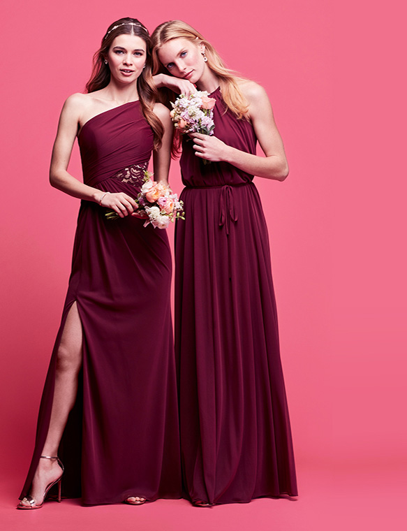 Two bridesmaids posing with bouquets | shop bridesmaid dresses