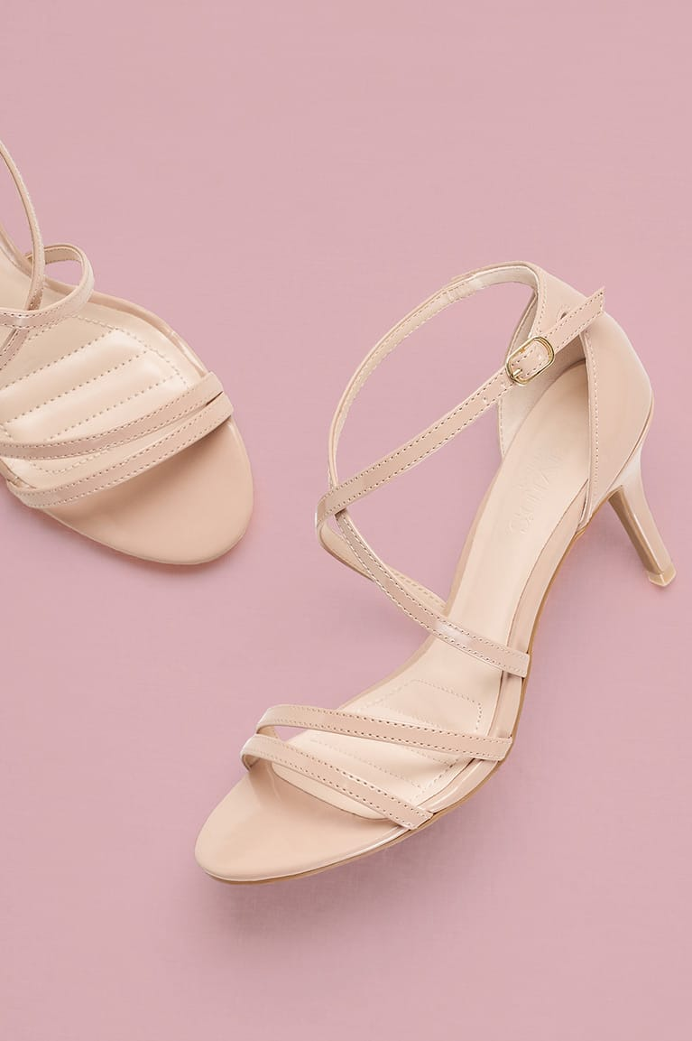 Nude patent strappy sandal with mid-height heel