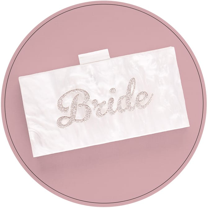 Marbled ivory clutch with Bride spelled out in sparkles